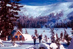 Image of Peter Grubb Hut and skiers